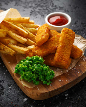 Fish fingers, mashed peas and chips fries. Traditional British fast food