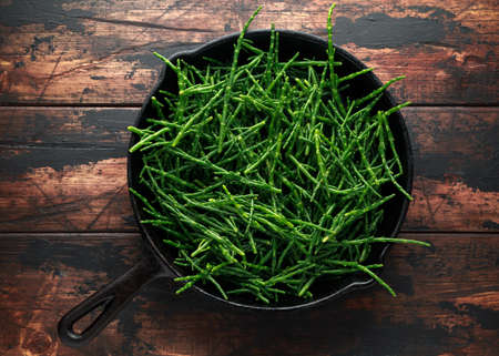 Fresh green samphire in cast iron skillet