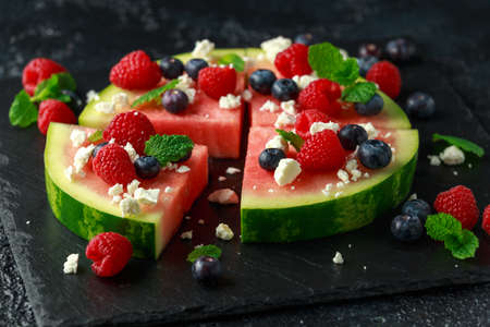 Juicy watermelon pizza with blueberries, raspberry feta cheese, mint. party food Banque d'images