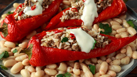 Stuffed pointed bell peppers with mince and basmati rice served with cannellini beans and chilli