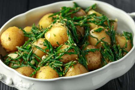 Boiled new potato with fresh samphire and garlic Stock Photo - 118414313