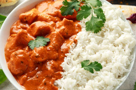 Chicken tikka masala curry with rice and naan bread. close up Stock Photo
