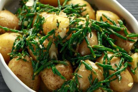 Boiled new potato with fresh samphire and garlic Stock Photo - 119118837