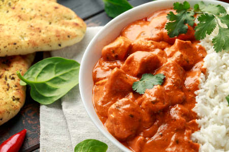 Chicken tikka masala curry with rice and naan bread. close up Stock fotó