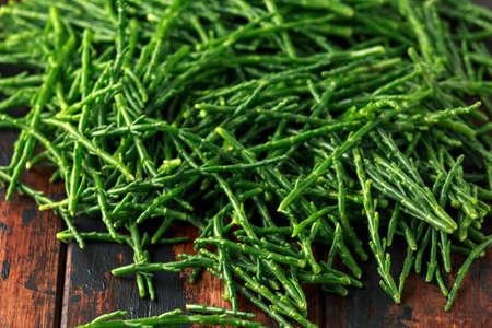 Fresh green raw samphire on wooden table Stock Photo - 119118859