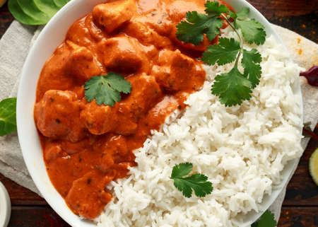 Chicken tikka masala curry with rice and naan bread