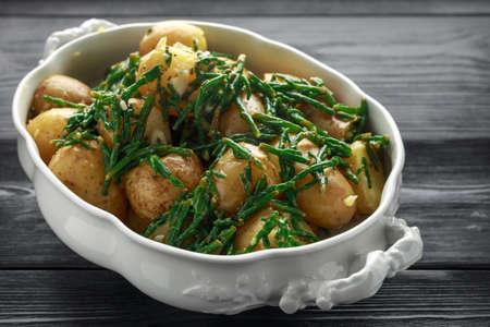 Boiled new potato with fresh samphire and garlic Stock Photo