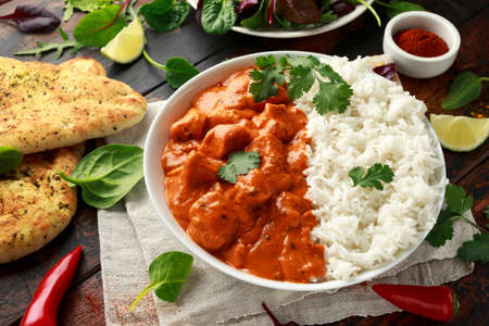 Chicken tikka masala curry with rice and naan bread Stock Photo - 120216995