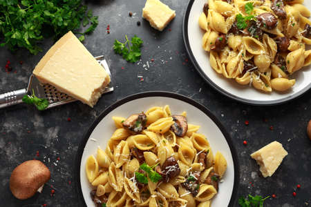 Conchiglie pasta with mushrooms, creamy sauce, parmesan cheese and herbs