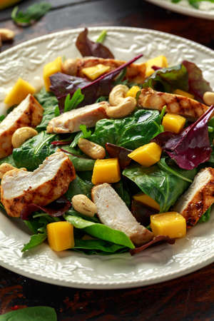 Grilled Chicken Mango salad with nuts and vegetables. Healthy food.