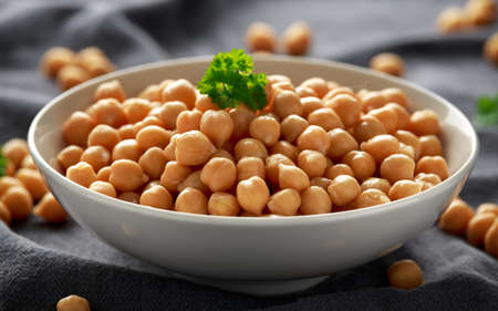 Fresh raw chickpeas in white bowl. Healthy food