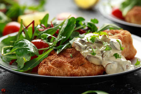 Chicken steak in Breadcrumbs with mushrooms and vegetables.