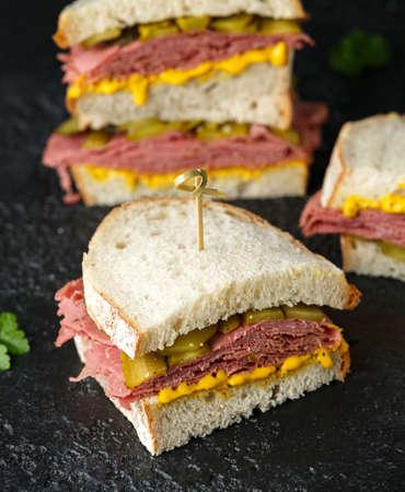 New York pastrami, gherkins and sourdough bread deli sandwich Stock Photo