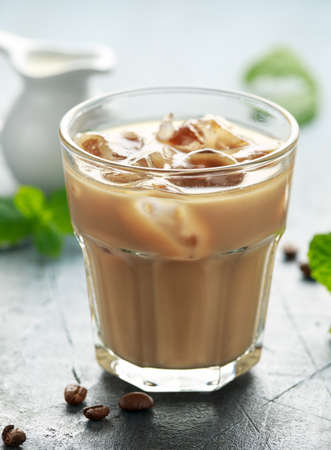 iced latte coffee in a glass with cold milk. Summer drink