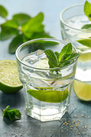 Mojito cocktail with Rum, lime and mint in glass. Summer cold drink with ice Stock Photo