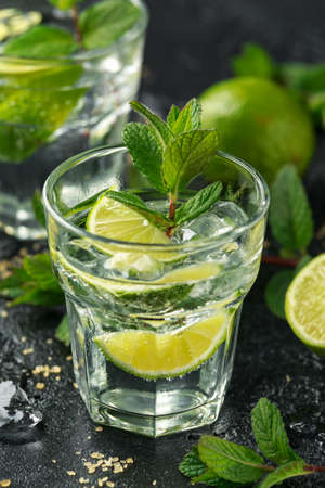 Mojito cocktail with Rum, lime and mint in glass. Summer cold drink with ice. Stock Photo