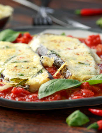 Grilled aubergine, eggplant topped with parmesan cheese crust on crashed tomatoes. Vegetarian pizza version Stok Fotoğraf