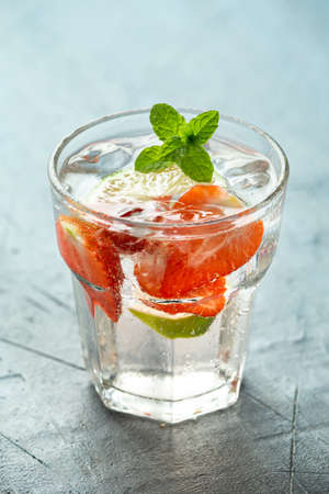 Strawberry Mojito cocktail with Rum, lime and mint in glass. Summer cold drink with ice Stock fotó