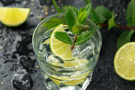 Mojito cocktail with Rum, lime and mint in glass. Summer cold drink with ice