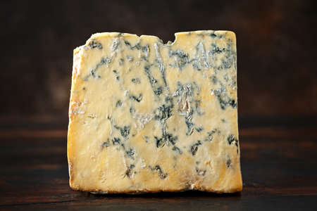 English Blue cheese stilton on rustic wooden background