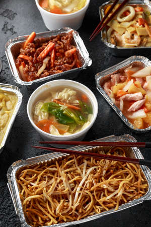 Chinese takeaway food. Pork Wonton dumpling soup, Crispy shredded beef, sweet and sour pineapple chicken, egg noodles with bean sprouts, curry Stock Photo