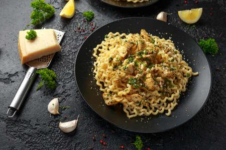 Artichoke hearts and lemon pasta with parmesan cheese and parsley Archivio Fotografico - 124335980
