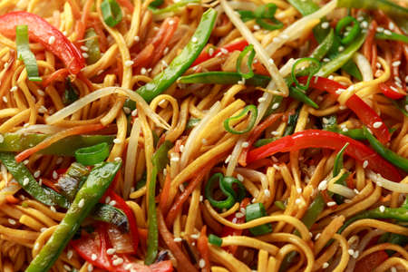 Chow mein noodle dish with vegetables. red pepper, carrot, mangetout and bean sprouts