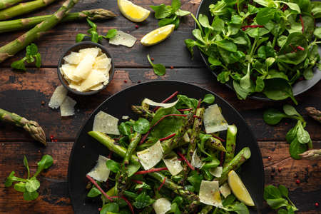 Grilled Asparagus salad with green vegetables and parmesan cheese 写真素材
