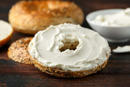 Bagels sandwich with cream cheese on wooden table 스톡 콘텐츠