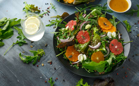 Orange and grapefruit Citrus salad with lentills vertes, wild rocket, arugula, red onion and sprinkle of pumpkin seeds