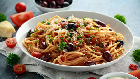 Pasta Alla Puttanesca with garlic, olives, capers, tomato and anchois fish.