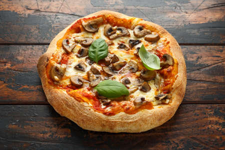 Hot Mushroom Pizza on wooden table. ready to eat. vegetarian food Archivio Fotografico