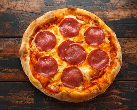 Pepperoni, Salami Pizza on wooden table. ready to eat