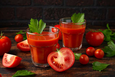 Tomato juice in glass with celery on rustic wooden table Stock fotó