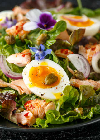 Smoked salmon and jammy soft-boiled free range egg and capers salad with edible borage and pansy flowers