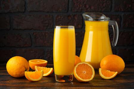 Orange juice in glass on rustic wooden table Stock fotó