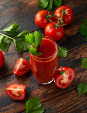 Tomato juice in glass with celery on rustic wooden table 스톡 콘텐츠