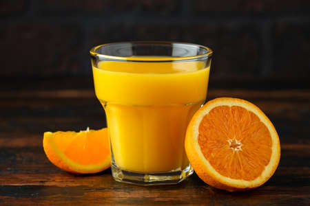 Orange juice in glass on rustic wooden table 스톡 콘텐츠