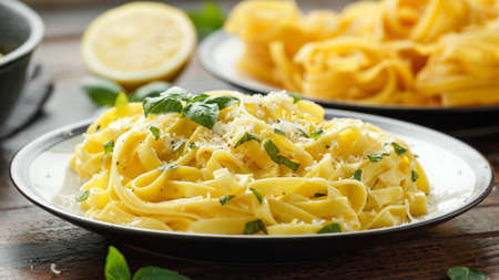 Pasta al Limone, Lemon with basil and parmesan cheese on wooden table