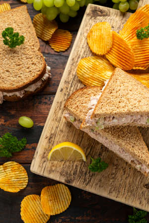 Healthy Tuna Sandwich with celery and onion on wooden board