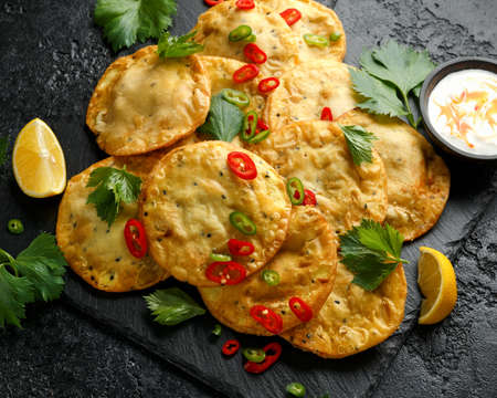 Traditional Indian snack food, chicken and vegetable staffing kachori.