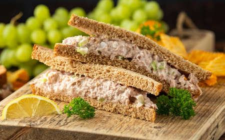 Healthy Tuna Sandwich with celery and onion on wooden board. Stock fotó