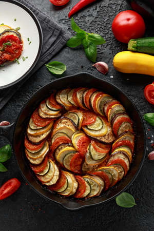 Ratatouille Vegetable Stew with zucchini, eggplants, tomatoes, garlic, onion and basil. on cast iron pan. Traditional French food. 스톡 콘텐츠
