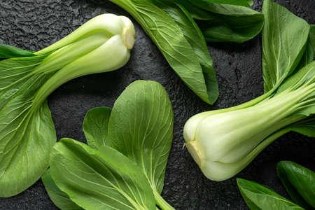 Pak Choi Chinese Cabbage on rustic black background Stock Photo