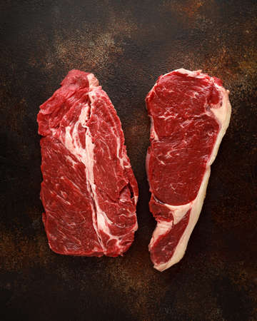 Raw fresh braising and sirloin beef steak butchers cut ready to cook. Stock Photo