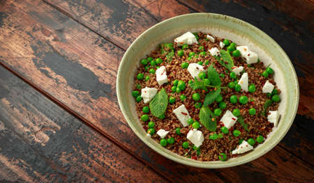 Quinoa salad with green pea, mint, feta cheese and chilli flake. healthy diet food