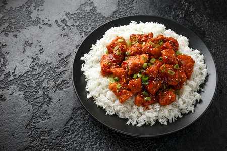 Tsos chicken with rice, green onion and broccoli