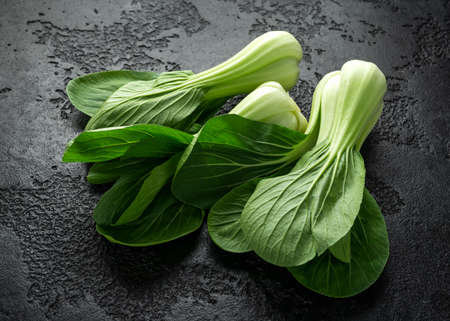 Pak Choi Chinese Cabbage on rustic black background 写真素材