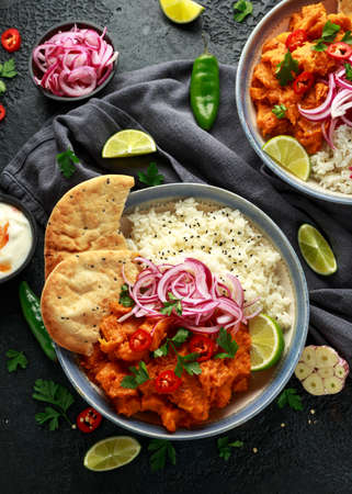 Meat free butternut squash curry with jasmine rice, pickled onions and naan bread. 스톡 콘텐츠