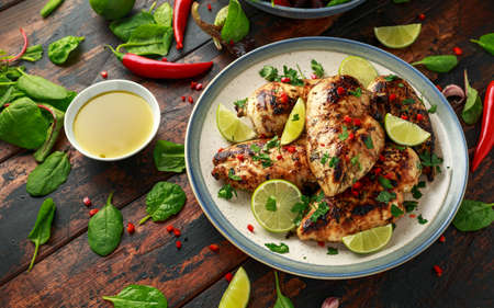 Homemade Grilled Chicken Breast in lime sauce with herbs.